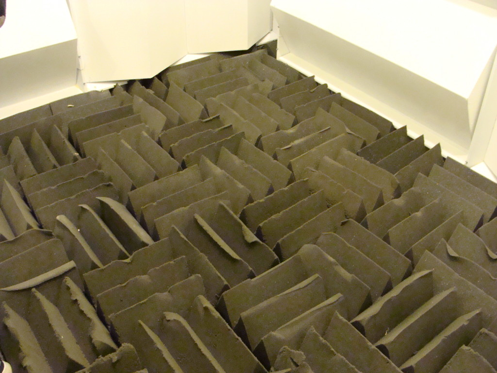 Foam pieces on the floor absorb sound and reduce reflections